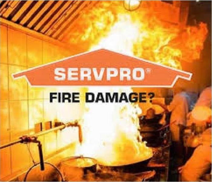 A kitchen fire with the SERVPROlogo over it.
