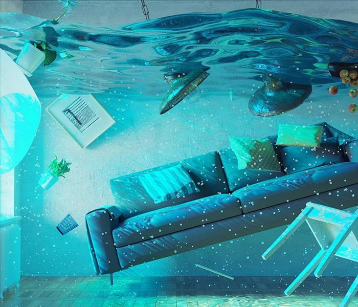An entire living room filled with water and everything floating.